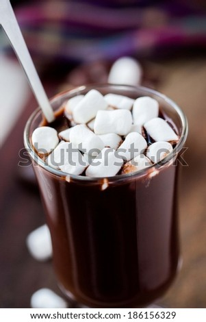 Drink hot chocolate with marshmallows in transparent glass, tasty sweet - stock photo