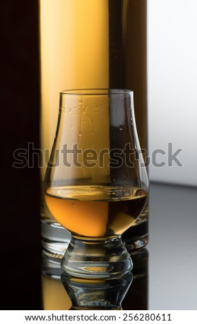 drink in a glass with a bottle - stock photo