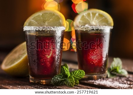 drink in shot glasses with lemon and sugar - stock photo