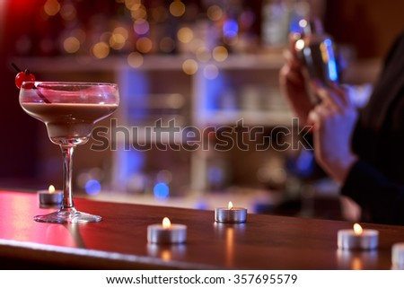 Drink in the club standing on the bar - stock photo