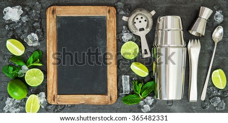 Drink making tools and ingredientsLime and mint leaves. Blackboard for recipe - stock photo