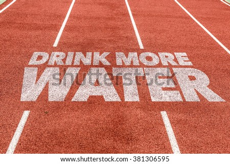 Drink More Water written on running track