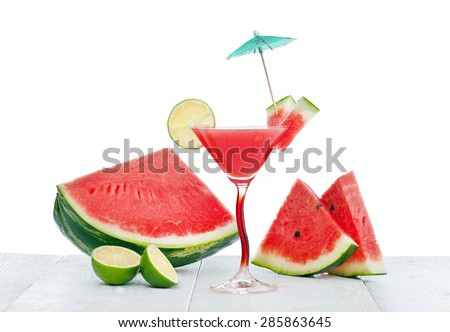 Drink of watermelon juice with lime slice on white background - stock photo