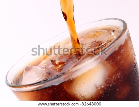 drink poured into a glass over white background - stock photo
