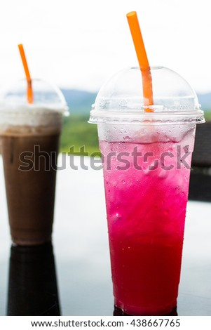 Drink red lime soda on mountain view. selective focus - stock photo