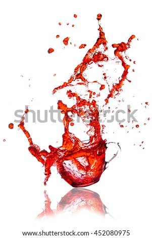 Drink red Splash out of glass on a white background.