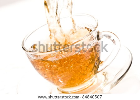 drink series: pouring tea into glassy tea cup