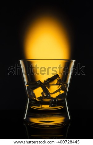 Drink shots in bar on color abstract background