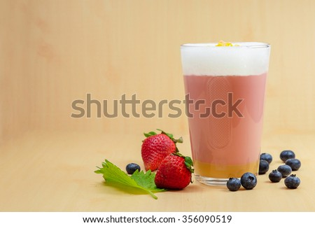 Drink smoothies strawberry, blackberry, raspberry on wooden table. - stock photo
