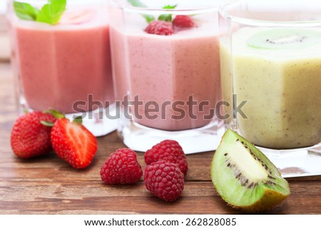 Drink smoothies summer strawberry, blackberry, raspberry on wooden table. - stock photo