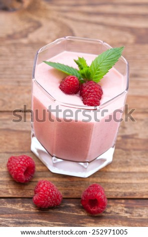 Drink smoothies summer strawberry, blackberry, raspberry on wooden table. Selective focus. - stock photo