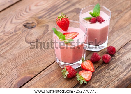 Drink smoothies summer strawberry, blackberry, raspberry on wooden table. Top view horizontal, Selective focus. - stock photo