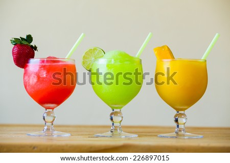 Drink special at a restaurant bar includes these three colored margaritas. - stock photo