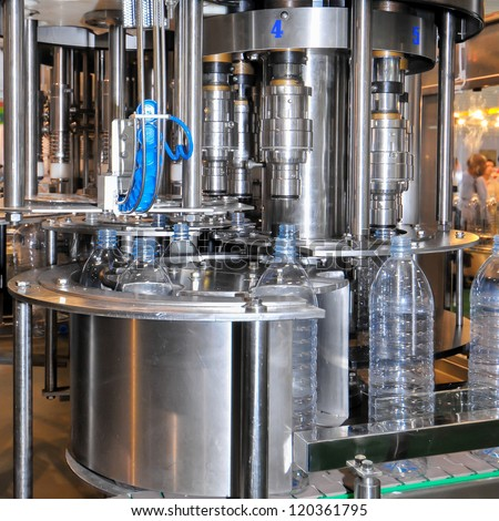 Drink water production line in industry - stock photo