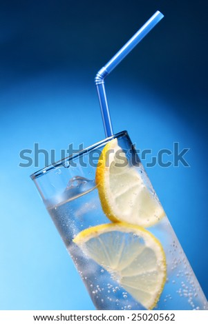 Drink with ice and lemon slice close-up - stock photo