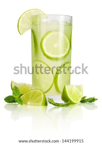 Drink with lime and ice isolated on white background - stock photo
