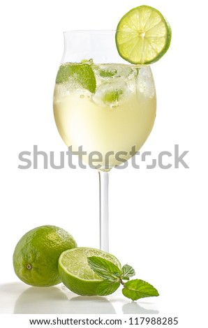 Drink with lime and mint in a wine glass - stock photo