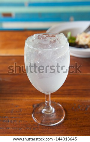Drink with lime soda in a wine glass - stock photo