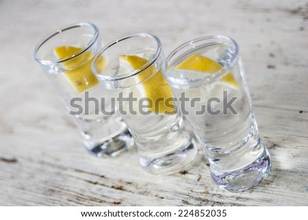 drink with vodka and lemon - stock photo