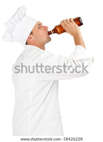 drinking alcohol chef in white uniform and hat with brown bottle