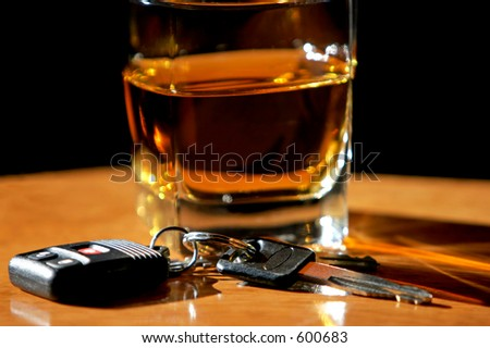 Drinking and Driving - Car keys and alcohol (shallow focus). - stock photo