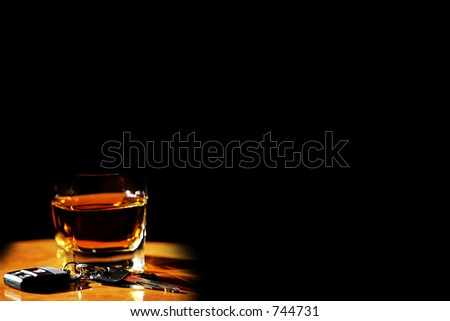 Drinking and Driving image - alcohol and car keys on black. - stock photo