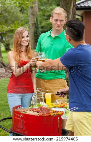Drinking beer on a garden party, vertical - stock photo