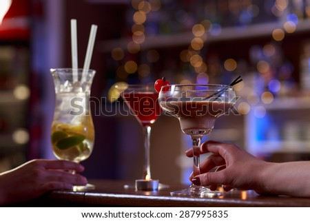 Drinking cocktails on the bar counter in the nightclub