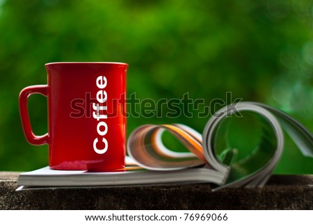 Drinking coffee and reading. In relaxation. - stock photo