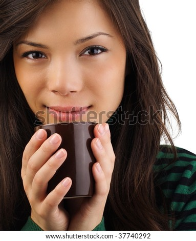 Drinking coffee. Beautiful mixed asian / caucasian woman drinking coffee or tea