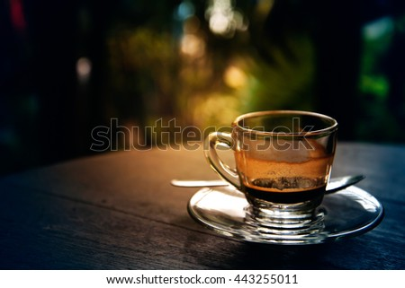 drinking coffee was decreased to half a cup on table in morning, espresso coffee, vintage style - stock photo