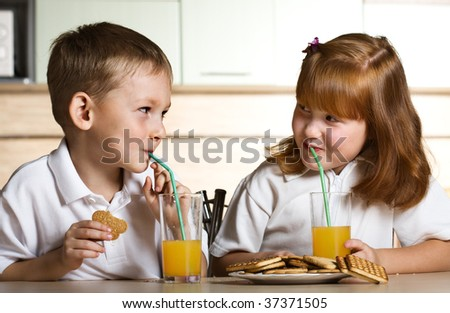 Drinking orange juice - stock photo