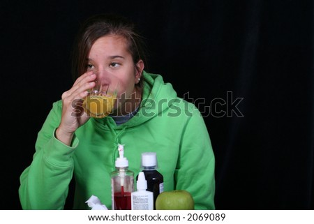 drinking orange juice to fight a cold...plus other remedies - stock photo