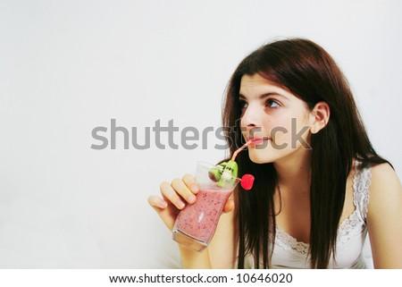 drinking smoothie - stock photo
