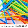 Drinking straw colorful plastic tubes over white as abstract background - stock photo