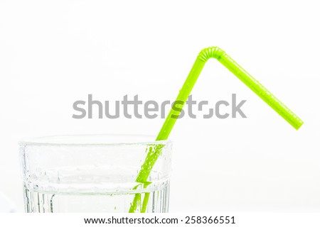 Drinking straws in the  glass of water.