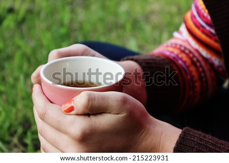 Drinking tea or a Cup of tea, Fall background, Good morning - stock photo