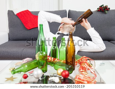 Drinking too much during Christmas time and New Year - stock photo