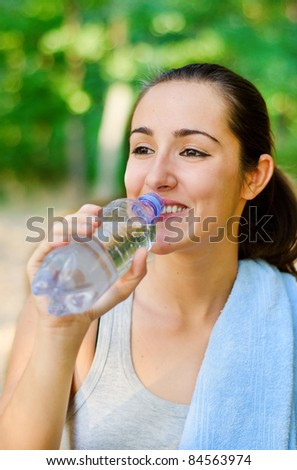Drinking water after hard workout - stock photo