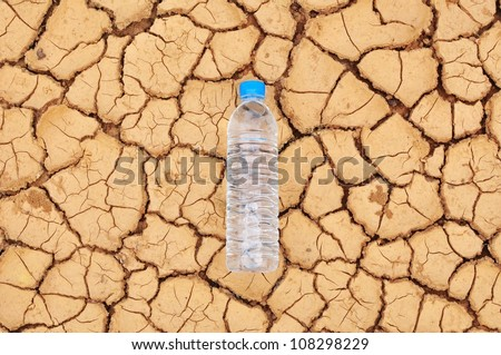 drinking water bottle on arid background - stock photo