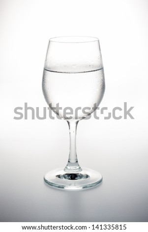 Drinking water in the wine glass - stock photo
