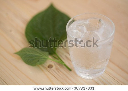 Drinking water on wooden background - stock photo