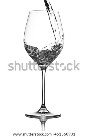 Drinking water pouring in wine glass