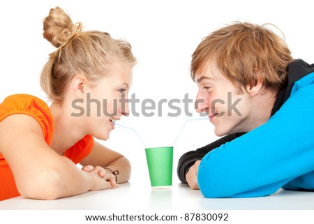 drinking with straws young loving couple - stock photo