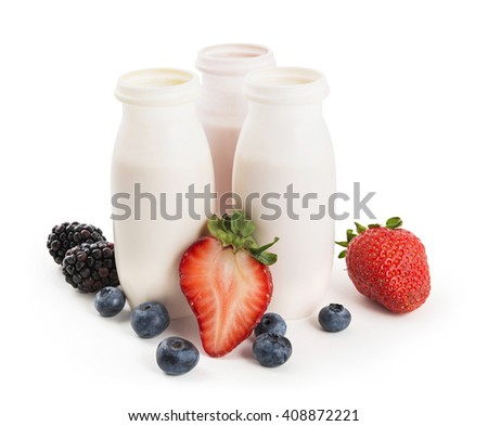 Drinking yogurts in plastic bottles and fresh berries on white background