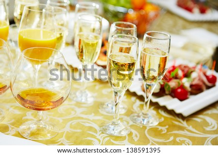 Drinks and canapes on table close-up - stock photo