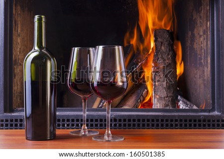 drinks at cozy fireplace on winters evening - stock photo