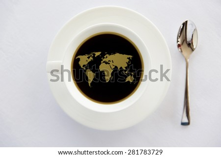 drinks, energetic, morning and caffeine concept - world map in cup of black coffee with saucer and spoon on table - stock photo
