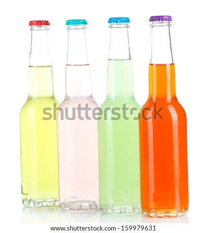 Drinks in glass bottles isolated on white - stock photo
