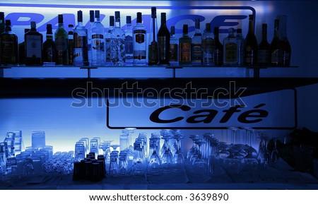 drinks in night club in blue light - stock photo
